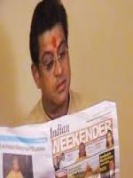 Amit Kumar reading newspaper