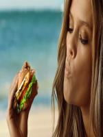 Nina Agdal while eating burger