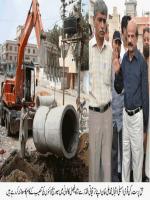 Iqbal Muhammad Ali Khan checking work