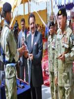 A. Rehman Malik Reciving Sword
