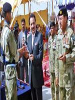A. Rehman Malik Reciving Sword