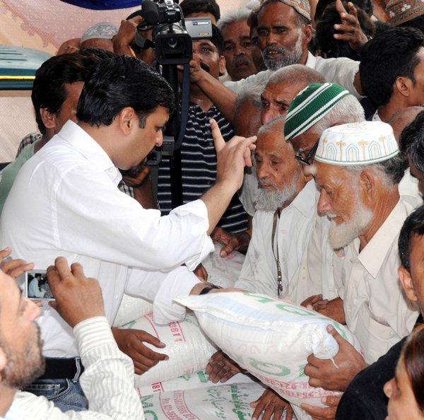 Syed Mustafa Kamal Distributing Relief