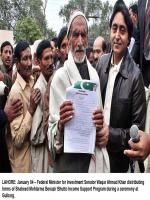 Waqar Ahmed Khan distributing forms