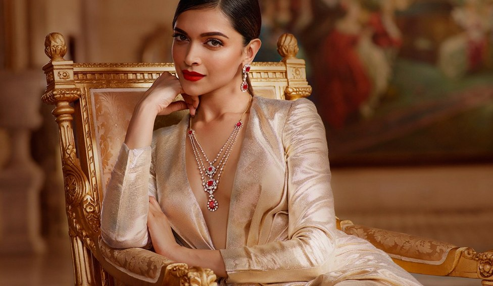 Deepika makes a bold statement in gold with hints of red. (Photo court