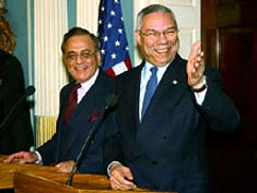 Khurshid Mahmud Kasuri with Colen Powel