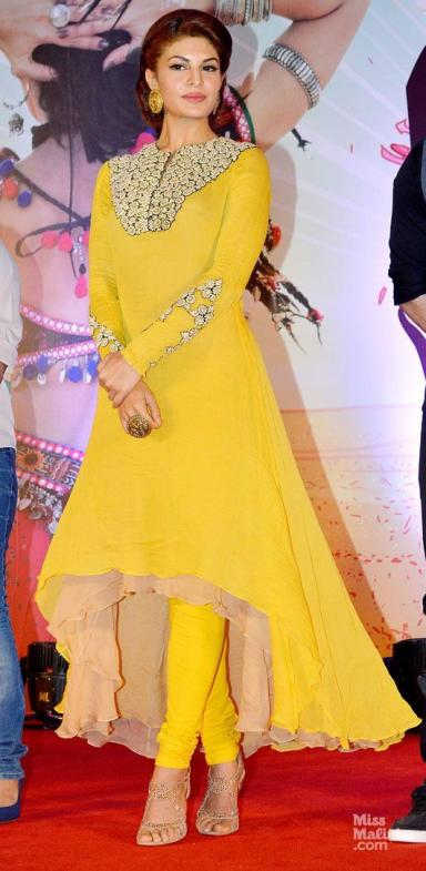 Jacqueline Fernandez. love the pop of yellow and high-low skirt!