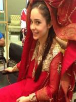 Juggan Kazim in Red Dress