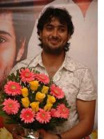 Uday Kiran With Flowers