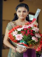 Saranya Mohan With Flowers