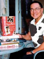 Gus Lee with his Books