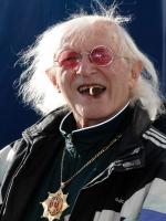 Jimmy Savile  in This Is Your Life books.