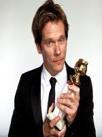Kevin Bacon receiving award