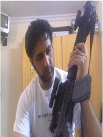 Asad Malik with Gun