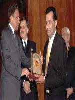 Ishtiaq Baig Reciving Award