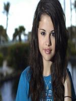 Selena Gomez wearing blue dress