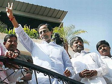 Chandrashekhar in showing victory sign