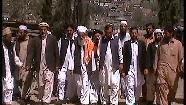 Qari Mohammad Yousif with Locals