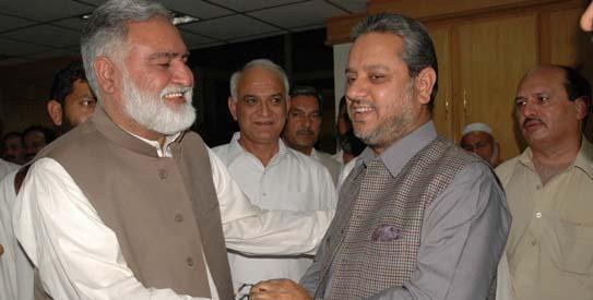Akram Khan Durrani with party members