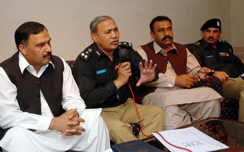 Malik Ibrar Ahmed with police