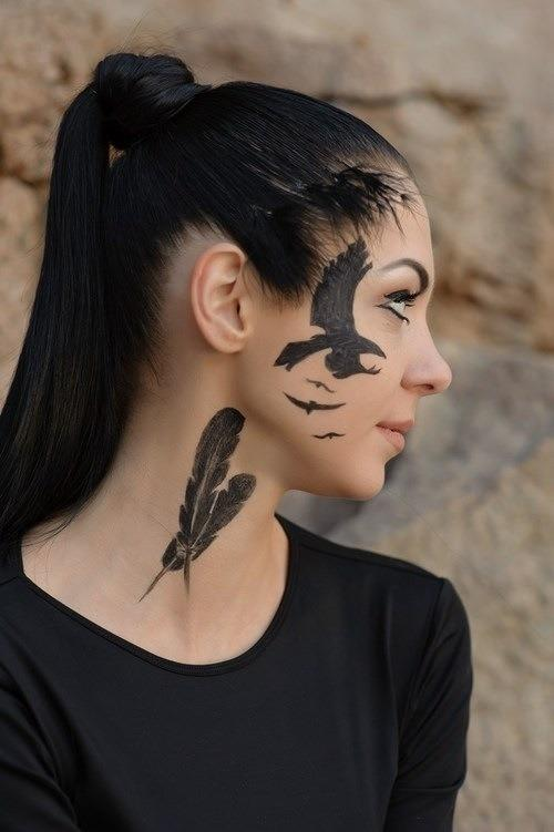 Bird on face tattoos
