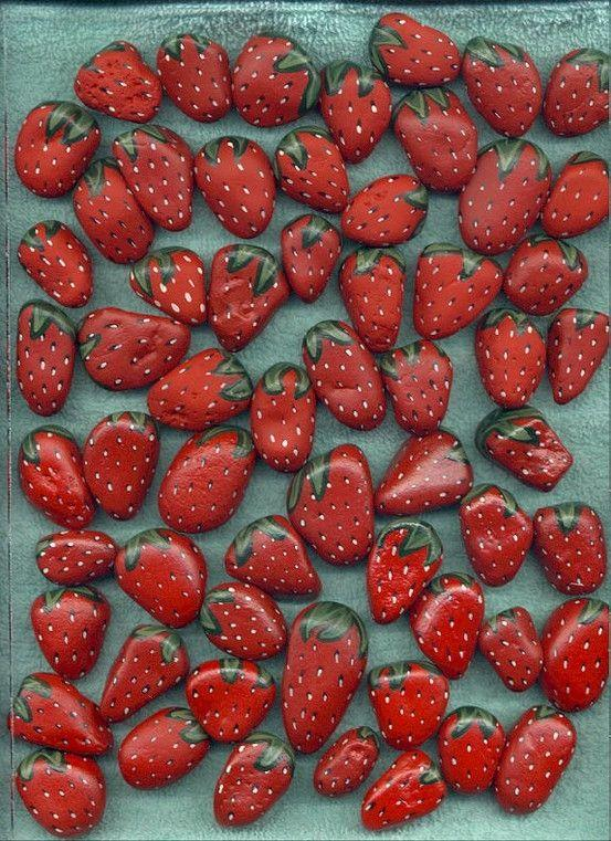 Painted strawberry rocks in your berry patch chase the birds away from