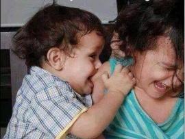 cute baby bitting sister