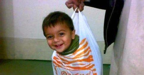 kid in a shopping bag haha