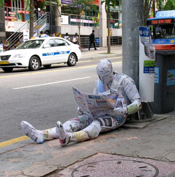 Man Wear Newspaper