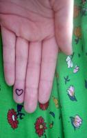 Heart tattoo at finger