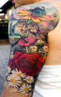 Beautiful vivid colors! Stunning floral sleeve tattoo.
