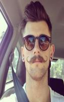 Super Mustache Style- too bad about the nose piercing but the hair and