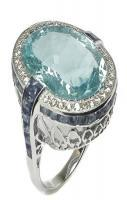 Oval aquamarine, sapphire, diamond, and white gold ring.