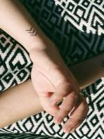 Small chevron tattoo which means create your own reality