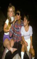 Michael Jackson... chugging vodka... 2 midgets on his lap... one holdi