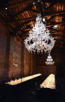 a contemporary styled chic party inside a rustic former barnyard in it