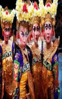 Adult female Balinese dancers pull funny faces