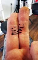 finger hug tattoo