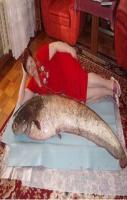 This woman gives sleeping with the fishes an entirely new meaning.