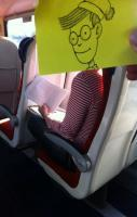 cartoon faces on sticky notes that he matches up with the bodies of un