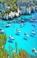 Menorca, Spain. Looks like the boats are flying