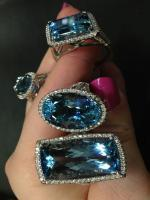 Aquamarine and diamond rings by Coast Diamond. Via Diamonds in the Library