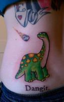 Dinosaur and meteor tattoo. This made me smile.