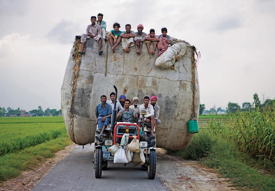 people hungry on tractor in india
