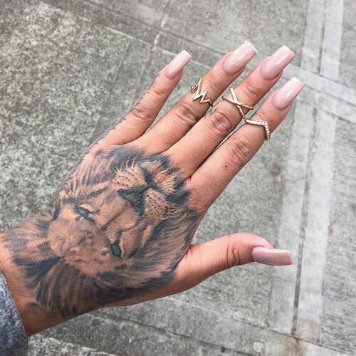 Lion tattoos on hand
