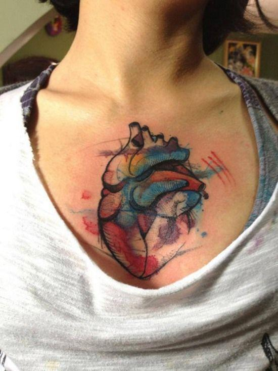 Watercolor chest heart tattoo