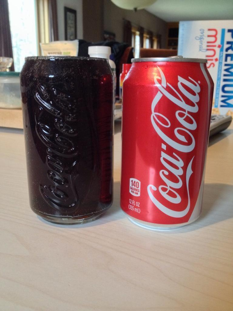 This glass holds exactly one can of soda, right to the brim
