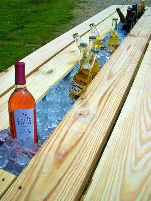 Replace board of picnic table with rain gutter. Fill with ice and enjo