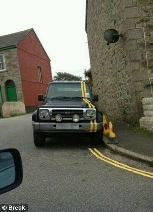 Poor workmanship, Double yellow lines have been painted over a car par