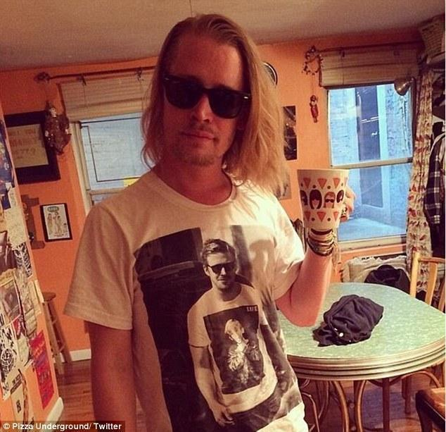 A picture of Macaulay Culkin wearing a t-shirt with a pciture Ryan Gos