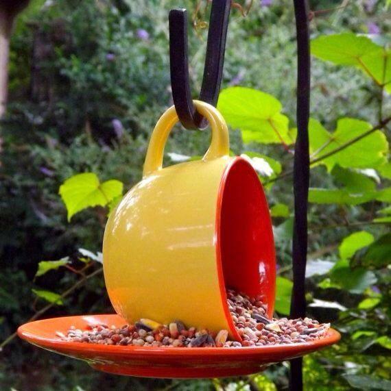 Hanging tea cup bird feeder